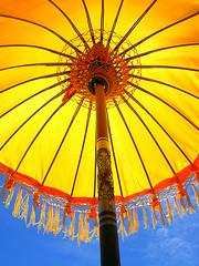 I Found The Sun Under The Umbrella (^riza^) Tags: blue bali yellow umbrella indonesia traditional 2006 thebiggestgroup indonesianphotobloggers
