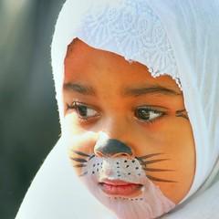 Wistful in whiskers (Java Cafe) Tags: portrait people girl face topv111 kids cat facepainting costume kid interestingness topf50 feline 500v20f child muslim hijab 100v10f topv3333 islamic f50 paintedface 111v1f 3333v33f interestingness112 i500 explore16jun06