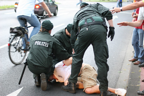 Unidentified England fan being arrested by Cologne police outside the stadium before the Sweden game