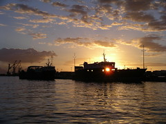 Sunset Behind A Ghost Ship (Itzl  ~~~) Tags: travel sunset sea sky sun nature water clouds island holidays top20sunrisesunset ships 2006 things sunsetsunrise elegance papeete 1on1 frenchpolynesia theone sdsee societyislands thecontinuum 123travel optio550 skyascanvas itzl