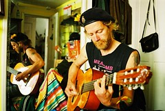 music maker (lomokev) Tags: portrait music man reflection male hat john beard mirror guitar moustache contax cap mustache agfa handbag ultra t2 agfaultra contaxt2 johnsc thecloud:selection=music roll:name=contaxt20606a file:name=contaxt20606a92