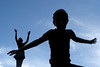 (sweetnsourtang) Tags: sky silhouette clouds children jumping statues 5hits