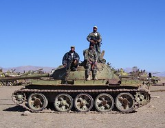 Afghan National Army soldiers happily posing on an old piece of Soviet armament. (violinsoldier) Tags: mountain afghanistan mountains soldier army ana war russia military terrorist osama vehicles soviet afghan terror terrorism osamabinladen soldiers russians ussr cccp afghani t55 soviets