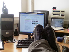 feet in front of computer