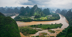 Spots of Sunshine (Greg - AdventuresofaGoodMan.com) Tags: china city mountains green nature field grass sunshine rain rio clouds river landscape liriver li asia rice terraces landmark hills viewpoint karst xianggong guangxi