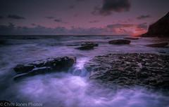 Southerdown beach looking west (Chris 656) Tags: sunset sea sky sun seascape beach water wales clouds canon rocks waves bridgend southerndown dunraven