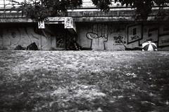 umbrella ella ella (Lup0s) Tags: nikonl35af nikon blackandwhite analog fujineopan1600 pull1000 trip homeless umbrella bahnhofzoo kripoe ogs purehate