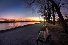 Some Enchanted Evening (KC Mike D.) Tags: missouri missouririver bench park englishlanding dusk sunset clouds hue pink lightpost lamppost lamp path gravel line leading riverbend reflection rainbow