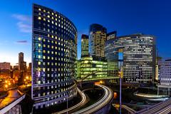 Rush hour at La Défense (Jheronimus) Tags: paris parijs frankrijk france architecture light trails blue hour modernarchitecture ladefense skyline outdoor building city