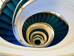staircase with a golden  handrail  and a blue carpet (rainerralph) Tags: berlin architektur spiral spirale deutschland staircase architecture germany omdem5markii stair objektiv714pro treppe