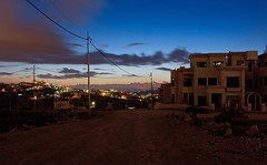 City taking over the land (humeid) Tags: ifttt 500px urban sprawl villa jordan amman sunset city telephone cables blue construction dirt