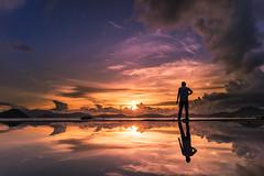 Lost In Dusk (mikemikecat) Tags: sunset sea sky people reflection clouds landscape hongkong mirror dusk sony voigtlander cityscapes bluesky 雲 日落 nokton 風景 天空 magicmoment 海邊 戶外 a7r 岸邊 vm21 mikemikecat