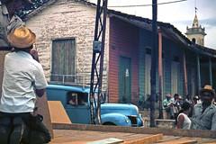STREET SCENE. CUBA 1976 (Manel Armengol C.) Tags: island cuba streetphotography streetscene communism isla comunismo comunista caribe bluetruck communistparty marxistleninist republicofcuba caribbeanisland marxistaleninista caribbeancountry isladecuba isladelcaribe manwithastrawhat