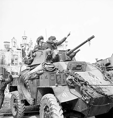 """Humber Armoured Car, Normandy, France.""<br />Personnel of the 17th Duke of York's Royal Canadian Hussars in their Humber Mk. IV armoured car in Normandy, France, 18-20 July 1944. (L-R): Sergeant G.B. Bradley, Trooper F.G. McKeown<br />"