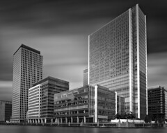 City Life (Clea Romeo) Tags: canary wharf london skyscrapers buildings offices uk blackandwhite long exposure cloudscape