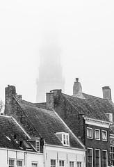 Hiding in the mist (Wouter de Bruijn) Tags: fujifilm xt1 fujinonxf90mmf2rlmwr blackandwhite bw monochrome fog mist haze urban landscape outdoor skyline architecture middelburg walcheren zeeland dutch holland netherlands langejan tower churchtower