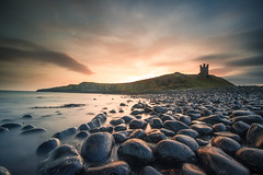 Golden sunrise (steveniceton.co.uk) Tags: castle ocean seascape sunrise rocks serene serenity tranquil tranquility longexposure