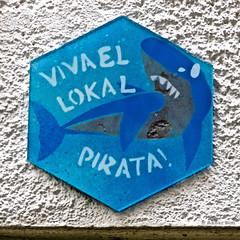 Viva El Lokal Pirata (Akbar Sim) Tags: streetart holland netherlands tile action protest nederland denhaag thehague piraat tegel aktie agga devloek akbarsimonse akbarsim