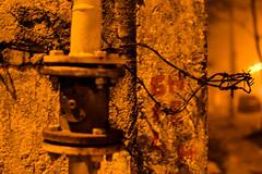The Misanthrope (avellium) Tags: light urban night corner dark concrete wire dof bokeh pipe gas misanthrope