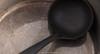 Ladle in kitchen pan. (annick vanderschelden) Tags: black bowl conveying deep dipper drink equipment food handle hot kitchenpan ladle lifting liquid metal oliveoil pan plastic pointofview pot reflection shadow soup tool belgium