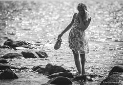 (Kalev Lait photography) Tags: bw blackandwhite girl woman blond dress summer sea water rocks stones shoes dof monochrome beach barefoot
