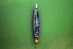 A lonely voyage (Aranya Ehsan) Tags: voyage people life lifestyle dailylife minimalism boat boatman bangladesh green background color colors chittagong