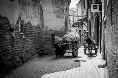 Hard labour @ Marrakech (PaulHoo) Tags: marrakech morocco monochrome blackandwhite 2016 candid streetcandid streetphotography people portrait medina contrast bw street urban streetlife labour wall texture decay transport