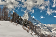 Season Greetings. The Matterhorn , the Symbol of Switzerland. a view from the train to Gornergrat from Zermatt .No, 4126. (Izakigur) Tags: liberty izakigur flickr feel europe europa dieschweiz ch helvetia lasuisse musictomyeyes nikkor nikon suiza suisse suisia schweiz romandie suizo swiss svizzera سويسرا laventuresuisse switzerland schwyz winter snow neige wham schnee train lepetitprince myswitzerland landscape alps alpes alpen zermatt matterhorn cervin cervino suïssa matterhornbahn trees nature nikond700 nikkor2470f28 white topf25 topf750 100faves 200faves 250faves 500faves 750faves wow