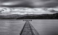 End of the track (David Feuerhelm) Tags: blackandwhite monochrome bw contrast nikkor wideangle longexposure outdoors water jetty mountains canterbury bankspeninsular serene newzealand nz silverefex nikon d7100