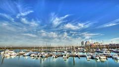 """a rising tide lifts all boats"" (genevieve van doren) Tags: breskens harbor port boats bateaux water sea mer sky ciel clouds nuages"