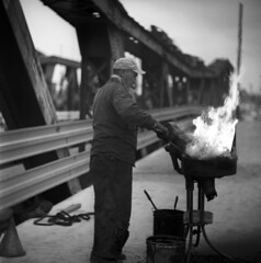 103259 11 (ndpa / s. lundeen, archivist) Tags: nick dewolf nickdewolf october bw blackwhite photographbynickdewolf 1959 1950s film 6x6 mediumformat monochrome blackandwhite chicago illinois southchicago ussteel steelmill steelplant southworks people man manatwork worker working equipment tools fire flame flames overalls hat cap bucket buckets industry industrial portofchicago