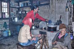 teashop in Sikkim (xtremepeaks) Tags: tea shop sikkim wood fire warm winter people old woman teashop india chai hut woodstove