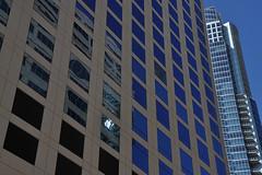 Austin - Blue Glass Windows (Drriss & Marrionn) Tags: blue usa building geometric lines architecture skyscraper buildings austin reflections texas outdoor streetscene blueskies minimalism modernarchitecture austintx streetviews buildingcomplex