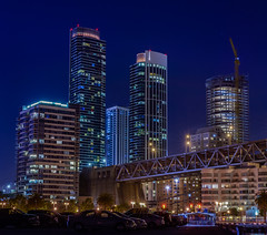 the right side of the bridge (pbo31) Tags: sanfrancisco california city blue summer panorama color june skyline night dark construction nikon crane over large panoramic embarcadero highrise luxury southbeach stitched d800 2015 rinconhill boury pbo31 pier30