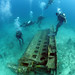 Divers dive onto a 22-ton engine block off the coast of Barbados