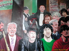 Ireland.- Irish Celebrity Mural in Belfast, Northern Ireland. Pic 2. (mrvisk) Tags: art painting young old picture history stone wall famous flute waistcoat diddy grey james galway alex higgins joey dunlop posters pic mature people groupshot ulster outdoor street music sport snooker mrvisk facial hair