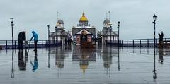 Rainy Day Reflections (SarahO44) Tags: iphone 7 eastbourne pier rain rainy reflections east sussex seaside sea umbrellas wood boardwalk mirror uk apple england united kingdom