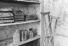 W State Hospital (Explore) (Jonnie Lynn Lace) Tags: abandoned abandonedamerica abandonedma newengland ma massachusetts statehospital peelingpaint paintchips decay derelict crutch shelves ruins modernruins jars mono monochrome bw blackandwhite light dark nikkor nikon d750 24mm white grey black texture textures inside interior indoors naturallight daylight day old urbex dusty history bright indoor westborough wow