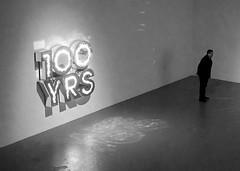 One Hundred Years of Solitude (Seeing Visions) Tags: 2016 unitedstates us california ca losangeles la downtown museumofcontemporaryart moca dougaitkin sculpture mirrors reflections text sansserif 100yrs illuminated person man guard standing monochrome bw raymondfujioka