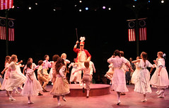 """Patrick Cassidy as Harold Hill and the company in the Music Circus production of """"The Music Man"""" at the Wells Fargo Pavilion July 31 - Aug 5. Photo by Charr Crail."""