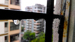 Drop Reflection (Vihang Panchal) Tags: house reflection building water rain shower dewdrops drops apartment rail drop grill monsoon droplet livingspace