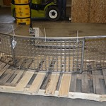 curved stainless steel panels to be attached to reception desk's face
