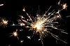 Sparks (Albert_Castle) Tags: stella orange white macro blanco yellow blackbackground fire lights star luces fireworks amarillo giallo fuego sparks naranja bianco luce fuoco fuegosartificiales arancione gunpowder anaranjado fuochidartificio polvora chispas estrellita macroworld explosionoflight fondonegro sfondonero explosionesdeluz