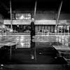 After The Rain #2 (Sean Batten) Tags: london england unitedkingdom gb reflection water rain puddle person city urban nikon df 35mm southbank pavement building