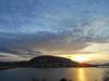 Rise and shine...time for work (kutruvis nick) Tags: greece greek hellas attiki lagonisi sun sunlight sunrise clouds sky mountain sea water houses landscape seaside coastline nik kutruvis nikoncoolpixs2900