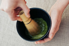 Making Matcha Tea (theteafarm) Tags: hand food cooking kitchen hands matcha tea green organic powder japanese powdered drink beverage healthy traditional ingredient oriental natural japan whisk gourmet culture ceremony maccha nature asian chinese herb bowl bamboo closeup lifestyle dry ground zen herbal cup spoon medicine aromatic wooden germany