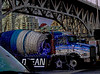 Festive Cement Mixer (bluechromis1) Tags: canont3i canonefs1855 vancouverbc winter city urban canada cementmixer christmaslights posterize bridge