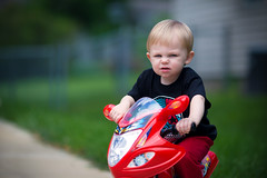 Goin' for a Ride (telks) Tags: red baby blur green bike canon bokeh smith kansascity stare motorcycle months 19 ridin