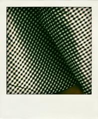 fold (PROD) Tags: black texture rock skirt structure textile fabric whites fold checkered textil stoff falte texturen plaids strukture kariert poladroid