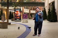 can empty the shopping centre in minutes, but the birds just love him :-) (teedee.) Tags: roma music player entertainers belfast street empty shopping centre birds deserted places composite image